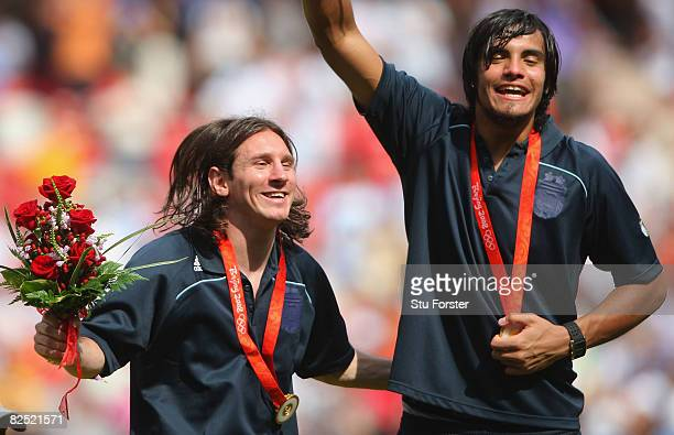 Lionel Messi and Sergio Romero of Argentina celebrate gold during the medal ceremony for the Men's Football at the National Stadium on Day 15 of the...