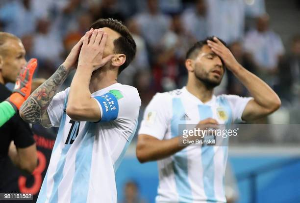 Lionel Messi and team mate Sergio Aguero of Argentina show their dejection during the 2018 FIFA World Cup Russia group D match between Argentina and...