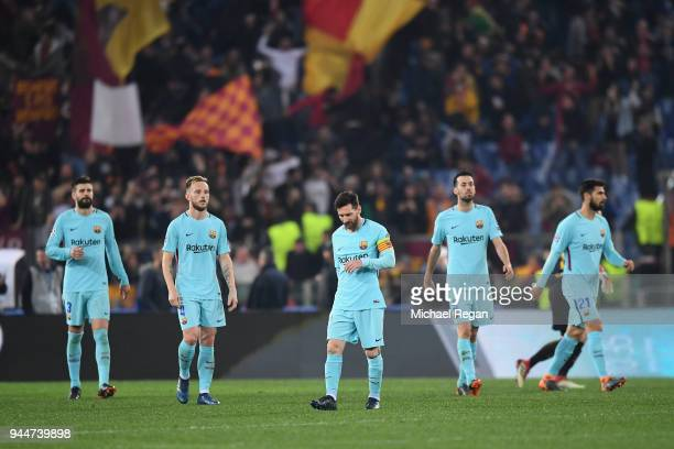 Lionel Messi and team mates look dejected after Roma's third goal the UEFA Champions League Quarter Final Second Leg match between AS Roma and FC...