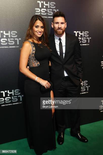 Lionel Messi and wife Antonella Roccuzzo arrive for The Best FIFA Football Awards Green Carpet Arrivals on October 23 2017 in London England