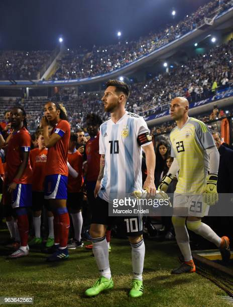 Lionel Messi and Willy Caballero of Argentina walk onto the field before an international friendly match between Argentina and Haiti at Alberto J...