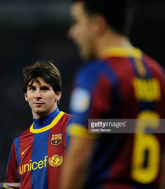 Lionel Messi and Xavi Hernandez of Barcelona look on during the La Liga match between Espanyol and Barcelona at Cornella El Prat stadium on December...