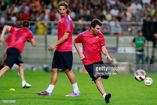 Lionel Messi and Zlatan Ibrahimovic of FC Barcelona attend during a training session at the Seoul Worldcup stadium on August 3 2010 in Seoul South...