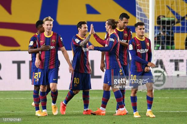 Lionel Messi, Antoine Griezmann and teammates of FC Barcelona celebrate their fourth goal during the La Liga Santander match between FC Barcelona and...