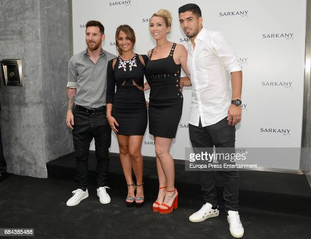 Lionel Messi Antonella Roccuzzo Sofia Balbi and Luis Suarez attend the opening of Sarkany Shoes Boutique on May 17 2017 in Barcelona Spain