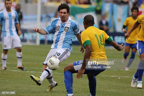 Lionel Messi Argentina flicks the ball past Juan Brazil during the Brazil V Argentina International Football Friendly match at MetLife Stadium East...
