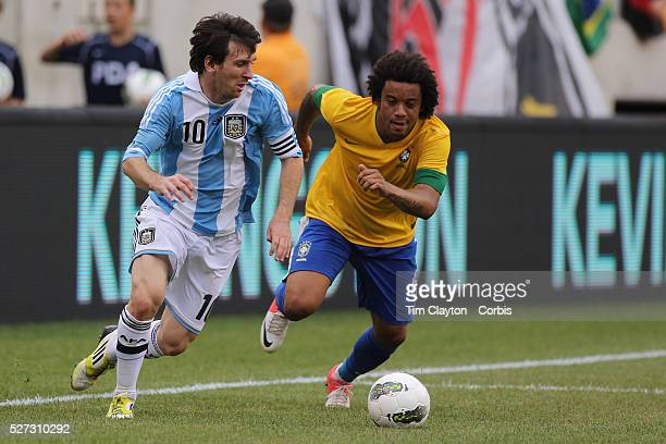 Lionel Messi Argentina goes past Marcelo Brazil during the Brazil V Argentina International Football Friendly match at MetLife Stadium East...