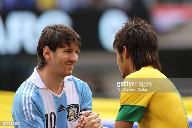 Lionel Messi Argentina shakes hands with Neymar Brazil during the team presentations before the Brazil V Argentina International Football Friendly...