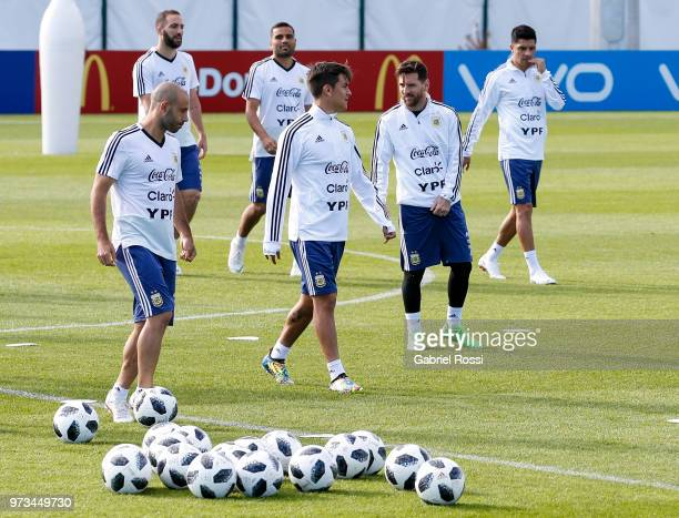Lionel Messi Argentina talks to Paulo Dyabala during an open to public training session at Bronnitsy Training Camp on June 11 2018 in Bronnitsy Russia