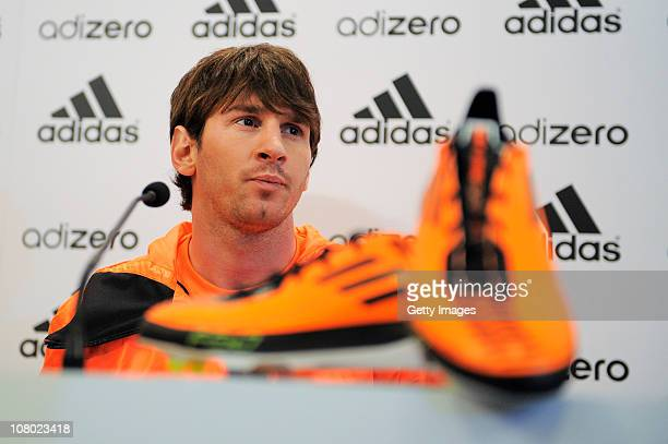 Lionel Messi attends a press conference during the launch of the new adiZero footwear range from adidas on January 13 2011 in Barcelona Spain