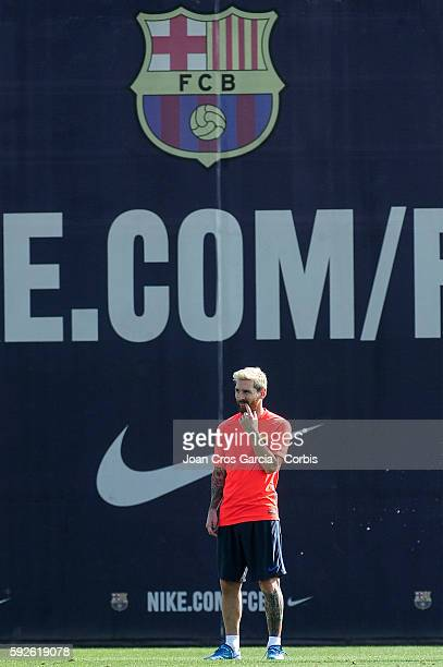Lionel Messi attends a training session at the Sports Center FC Barcelona Joan Gamper before the first Spanish League match between FCBarcelona and...