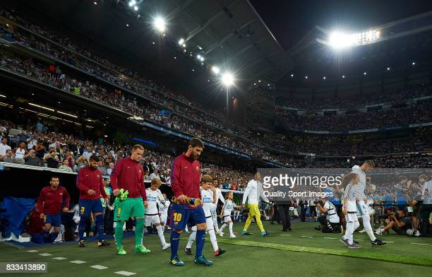 Lionel Messi Barcelona makes his way out on to the pitch prior to kickoff the Supercopa de Espana Supercopa Final 2nd Leg match between Real Madrid...