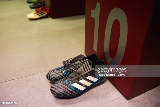 Lionel Messi boots are seen in the FC Barcelona dressing room before the UEFA Champions League Round of 16 Second Leg match between FC Barcelona and...
