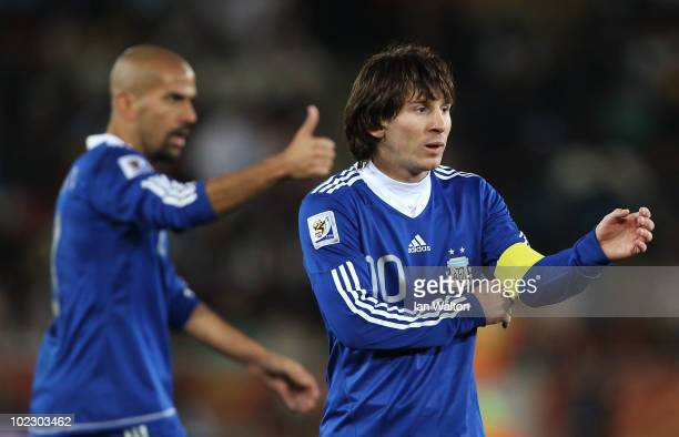 Lionel Messi captain of Argentina looks on with Juan Veron during the 2010 FIFA World Cup South Africa Group B match between Greece and Argentina at...