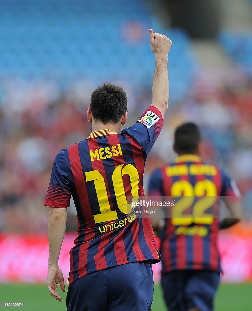 Lionel Messi celebrates after scoring FC Barcelona's opening goal during the La Liga match between UD Almeria and FC Barcelona on September 28, 2013 in Almeria, Spain.