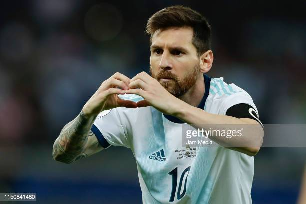 Lionel Messi celebrates after scoring his side's first goal during the Copa America Brazil 2019 group B match between Argentina and Paraguay at...