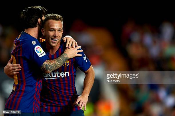 Lionel Messi celebrates goal with teammates Arthur Melo during the week 8 of La Liga match between Valencia CF and FC Barcelona at Mestalla Stadium...