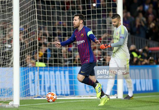 Lionel Messi celebrates his first goal on a penalty kick while goalkeeper of Lyon Anthony Lopes looks down during the UEFA Champions League Round of...