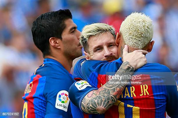 Lionel Messi celebrates scoring their fourth goal with teammates Neymar JR and Luis Suarez during the La Liga match between Deportivo Leganes and FC...