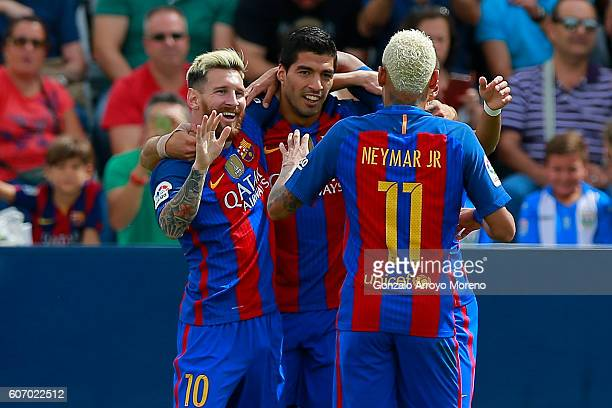 Lionel Messi celebrates scoring their opening goal with teammate Luis Suarez and Neymar JR during the La Liga match between Deportivo Leganes and FC...