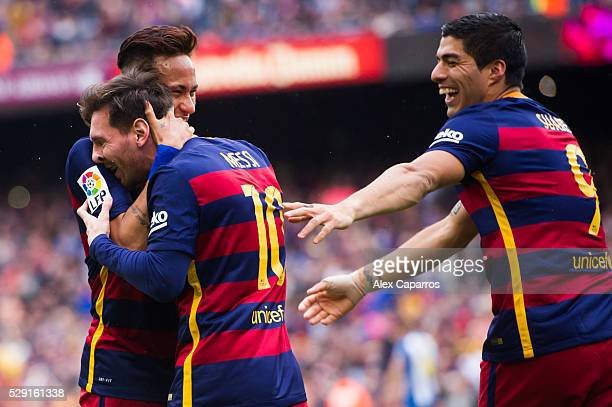 Lionel Messi celebrates with his teammates Neymar Santos Jr and Luis Suarez after scoring the opening goal during the La Liga match between FC...