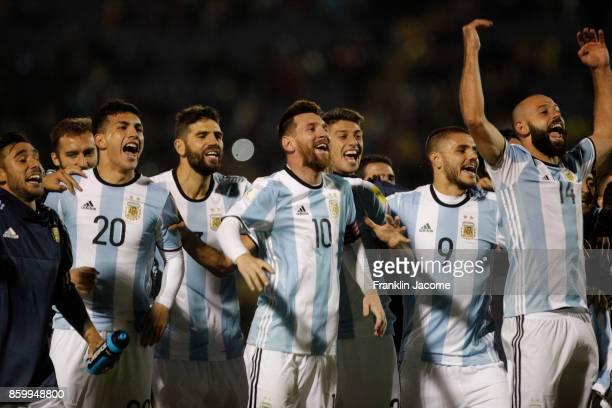 Lionel Messi celebrates with his teammates qualifying to the World Cup after winning a match between Ecuador and Argentina as part of FIFA 2018 World...