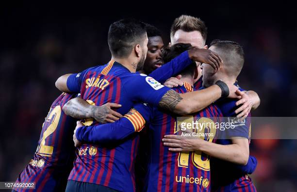 Lionel Messi celebrates with teammates after scoring his team's second goal during the La Liga match between FC Barcelona and RC Celta de Vigo at...