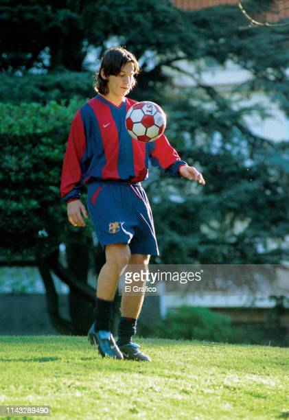 Lionel Messi controls the ball during a private photo session for El Gráfico magazine on October 12, 2003 in Rosario, Argentina.