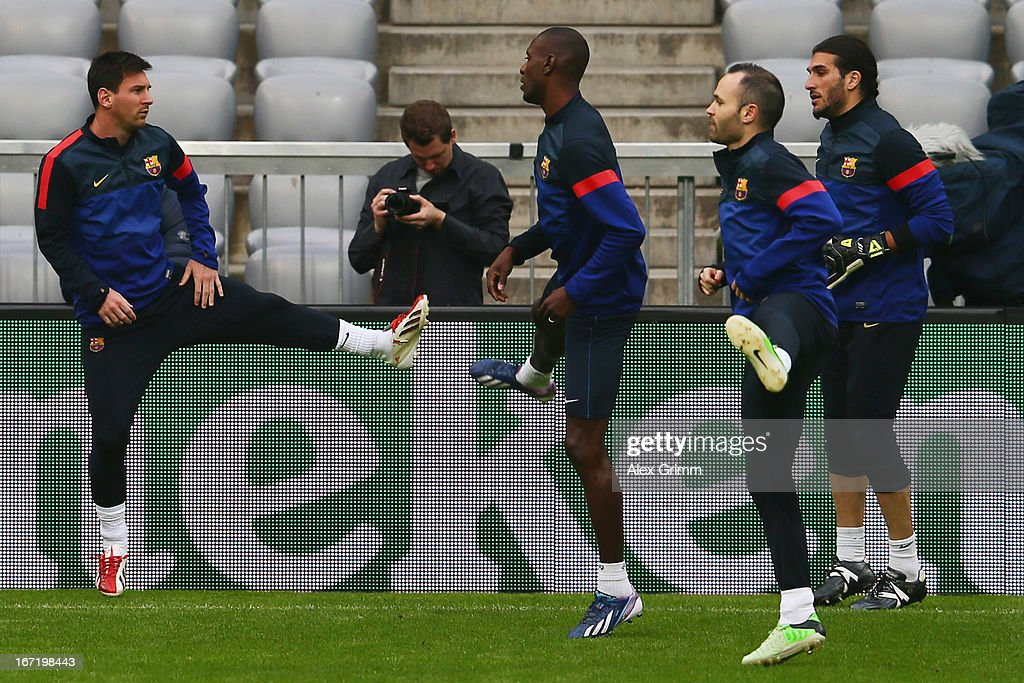 Lionel Messi, Eric Abidal, Andres Iniesta and Jose Manuel Pinto (L-R) exercise during a FC Barcelona press conference ahead of their UEFA Champions League Semi Final first leg match against FC Bayern Muenchen on April 22, 2013 in Munich, Germany.