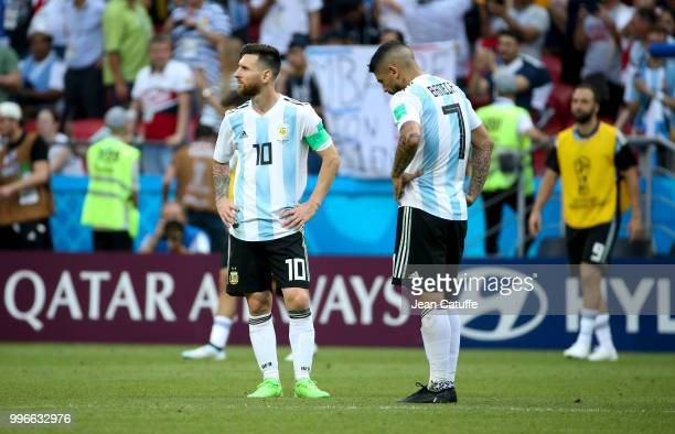 Lionel Messi Ever Banega of Argentina react following the 2018 FIFA World Cup Russia Round of 16 match between France and Argentina at Kazan Arena on...