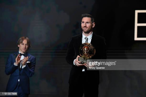 Lionel Messi excepts his sixth Ballon D'Or award from Luka Modric during the Ballon D'Or Ceremony at Theatre Du Chatelet on December 02 2019 in Paris...
