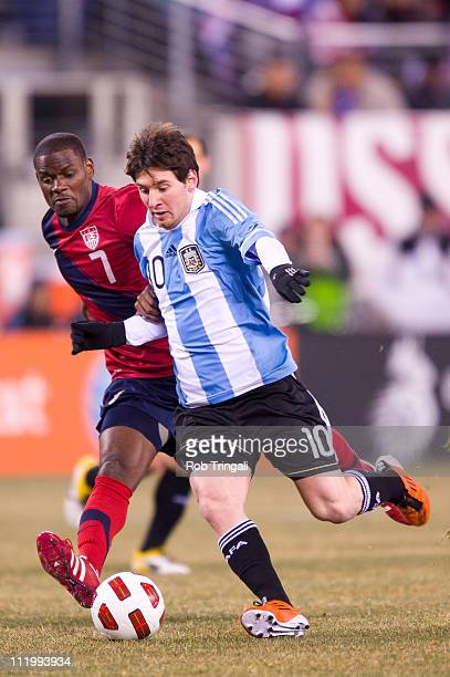Lionel Messi forward of Argentina dribbles with the ball as Maurice Edu of the USA defends in a Soccer friendly on March 26 2011 at the New...