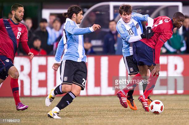 Lionel Messi forward of Argentina fights for the ball as Maurice Edu of the USA defends in a Soccer friendly on March 26, 2011 at the New Meadowlands...