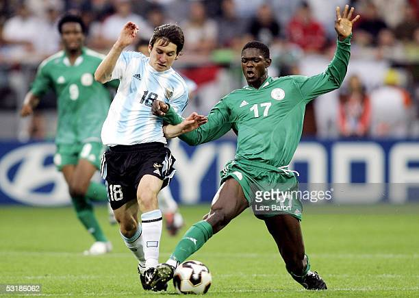 Lionel Messi from Argentina challenges Dele Adeleye from Nigeria for the ball during the FIFA World Youth Championships 2005 Final between Argentina...