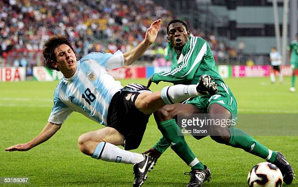 Lionel Messi from Argentina in action with Dele Adeleye from Nigeria during the FIFA World Youth Championships 2005 Final between Argentina and...