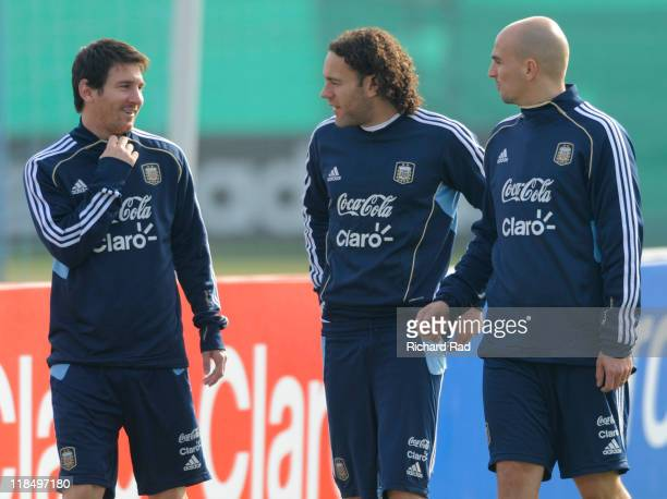 Lionel Messi Gabriel Milito and Esteban Cambiasso talk together after a training session at the Asociacion Argentina de Futbol facilities on July 08...