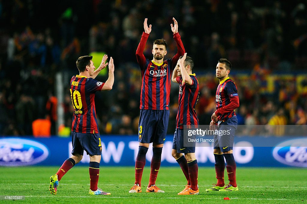 Lionel Messi, Gerard Pique, Andres Iniesta and Jordi Alba of Barcelona celebrate their team's 2-1 victory during the UEFA Champions League Round of 16, second leg match between FC Barcelona and Manchester City at Camp Nou on March 12, 2014 in Barcelona, Spain.