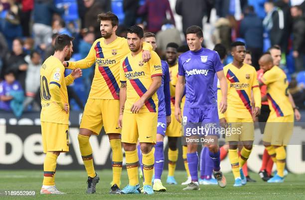 Lionel Messi Gerard Pique C and Luis Suarez of FC Barcelona celebrate their 21 victory after the La Liga match between CD Leganes and FC Barcelona at...