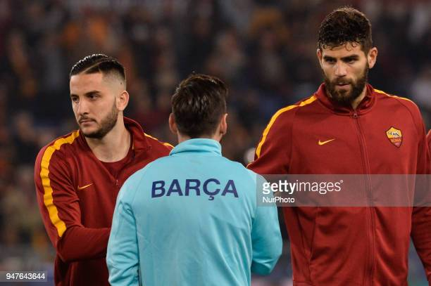 Lionel Messi greets Kostas Manolas and Federico Fazio during the UEFA Champions League quarter final match between AS Roma and FC Barcelona at the...