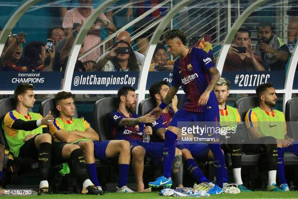 Lionel Messi greets Neymar of Barcelona as he comes to the bench during their International Champions Cup 2017 match against Real Madrid at Hard Rock...