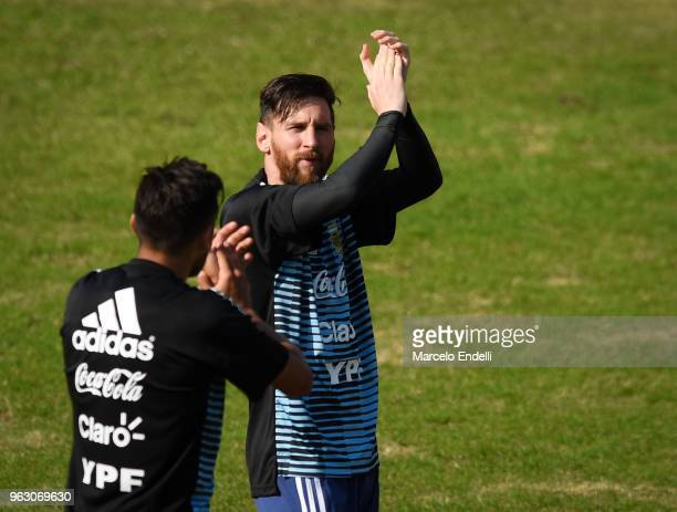 Lionel Messi greets the fans during a training session open to the public as part of the team preparation for FIFA World Cup Russia 2018 at Tomas...