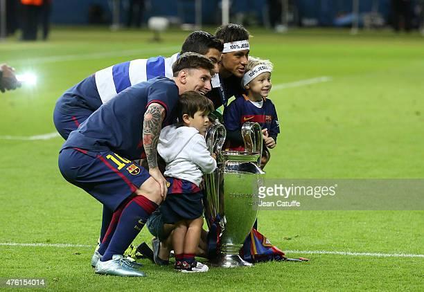 Lionel Messi, his son Thiago Messi, Luis Suarez, Neymar Jr and his son David Lucca da Silva Santos celebrate the victory after the UEFA Champions...