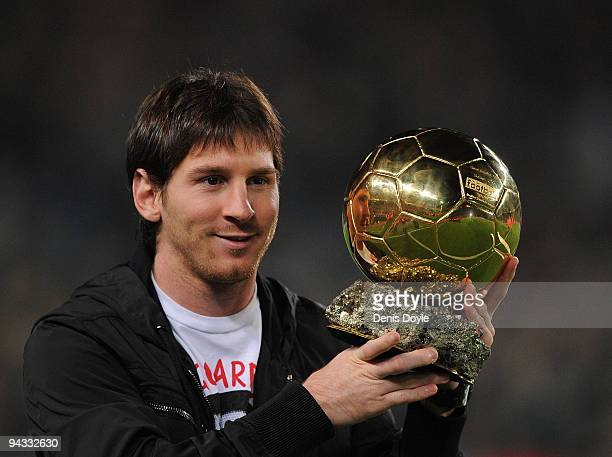 Lionel Messi holds up his European footballer of the year award the 'Ballon d'Or' before the La Liga match between Barcelona and Espanyol at the Camp...