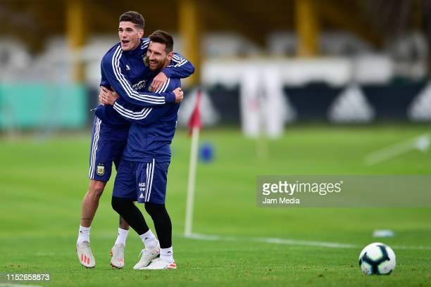 Lionel Messi hugs Rodrigo De Paul during a training session at Julio H. Grondona Training Camp on May 30, 2019 in Ezeiza, Argentina.