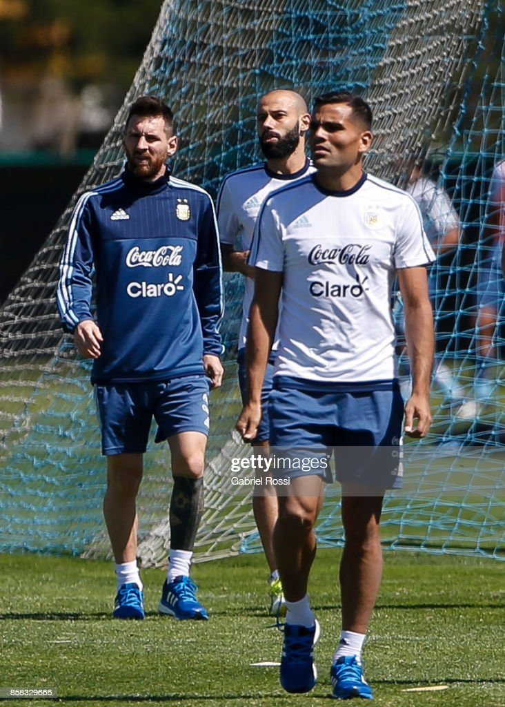 Lionel Messi, Javier Mascherano and Gabriel Mercado of Argentina look on during a training session at Argentine Football Association (AFA) 'Julio Humberto Grondona' training camp on October 06, 2017 in Ezeiza, Argentina.