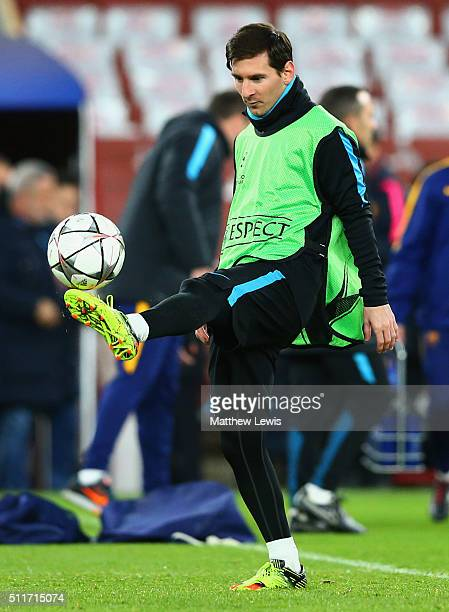 Lionel Messi juggles the ball during a FC Barcelona training session ahead of their UEFA Champions League round of 16 first leg match against Arsenal...
