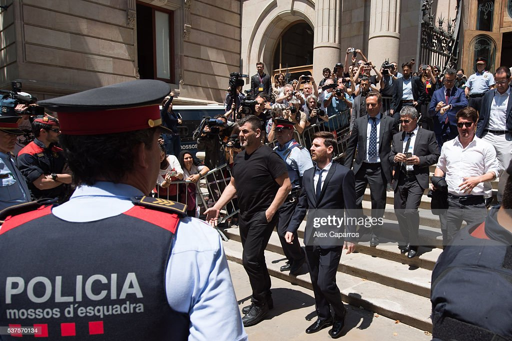 Lionel Messi leaves the courthouse followed by his father Jorge Horacio Messi (2nd row C) and his brother Rodrigo Messi (2nd row R) on June 2, 2016 in Barcelona, Spain. Lionel Messi and his father Jorge Messi, who manages his financial affairs, are accused of defrauding the Spanish Tax Agency of 4.1 million Euros ($4.6 million, £3.2 million) by using companies based in tax havens such as Belize and Uruguay to conceal earnings from image rights during years 2007 to 2009.