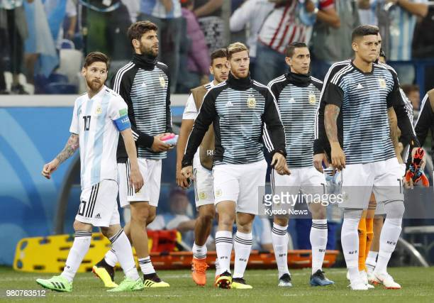 Lionel Messi leaves the field along with other Argentina players after a 30 loss to Croatia in a World Cup group stage match in Nizhny Novgorod...