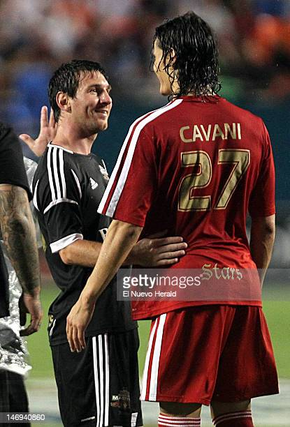 Lionel Messi left and Edinson Cavani greet each other at the end of the match between the Red Stars and the Black Masters in The World Soccer Masters...
