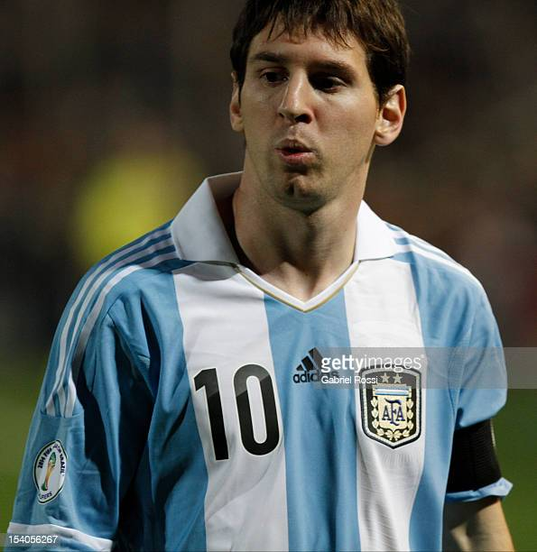 Lionel Messi looks on after scoring two goals during a match between Argentina and Uruguay as part of the South American Qualifiers for the FIFA...